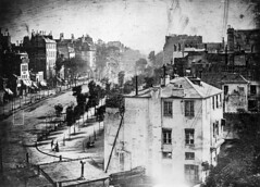 Perfecting the photographic process, Louis Daguerre was able to include _______ in his photographs, as seen in his 1839 photo Le Boulevard du Temple.