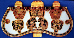 The Purse Cover from the Sutton Hoo ship burial illustrates one distinguishing characteristic of the art of migrating peoples of the Middle Ages that is based on: